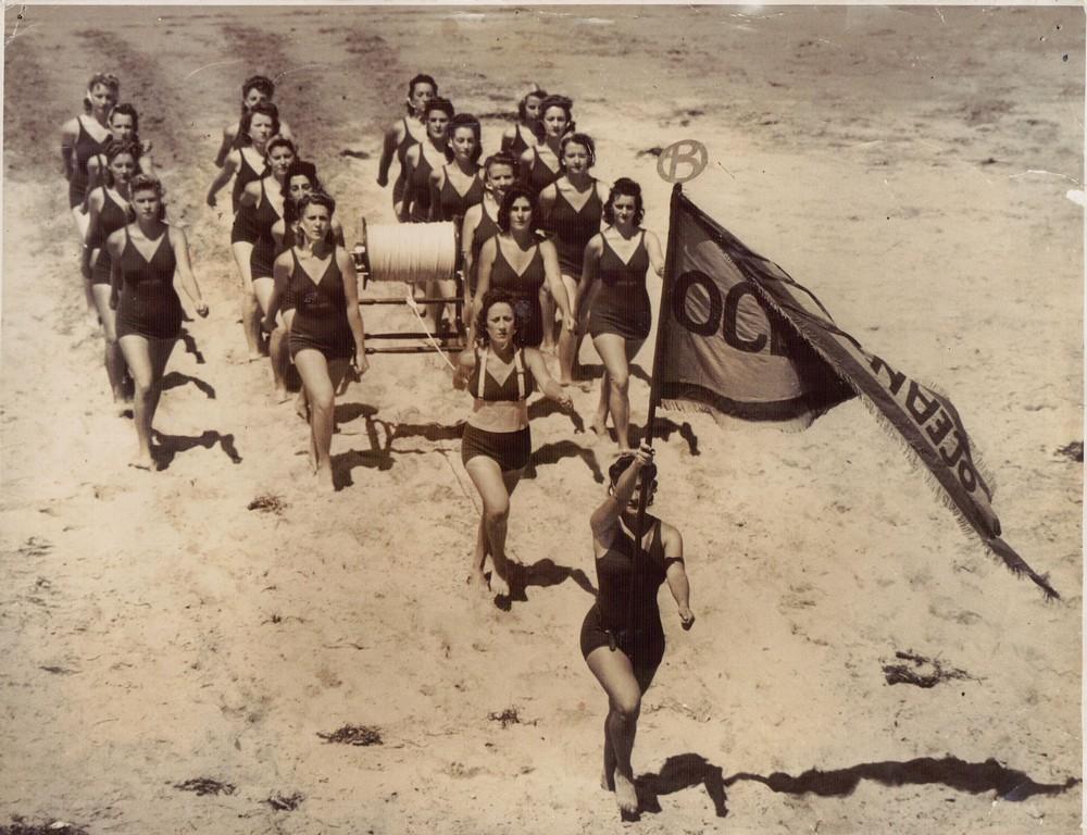 140 Ob women march past