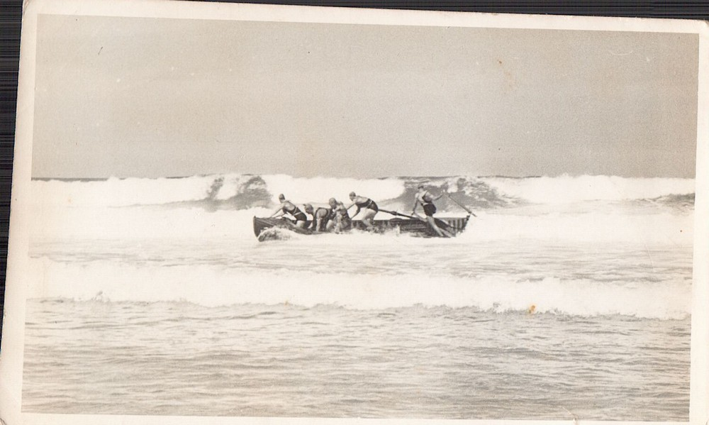 148 OB old boat about to get hit by wave