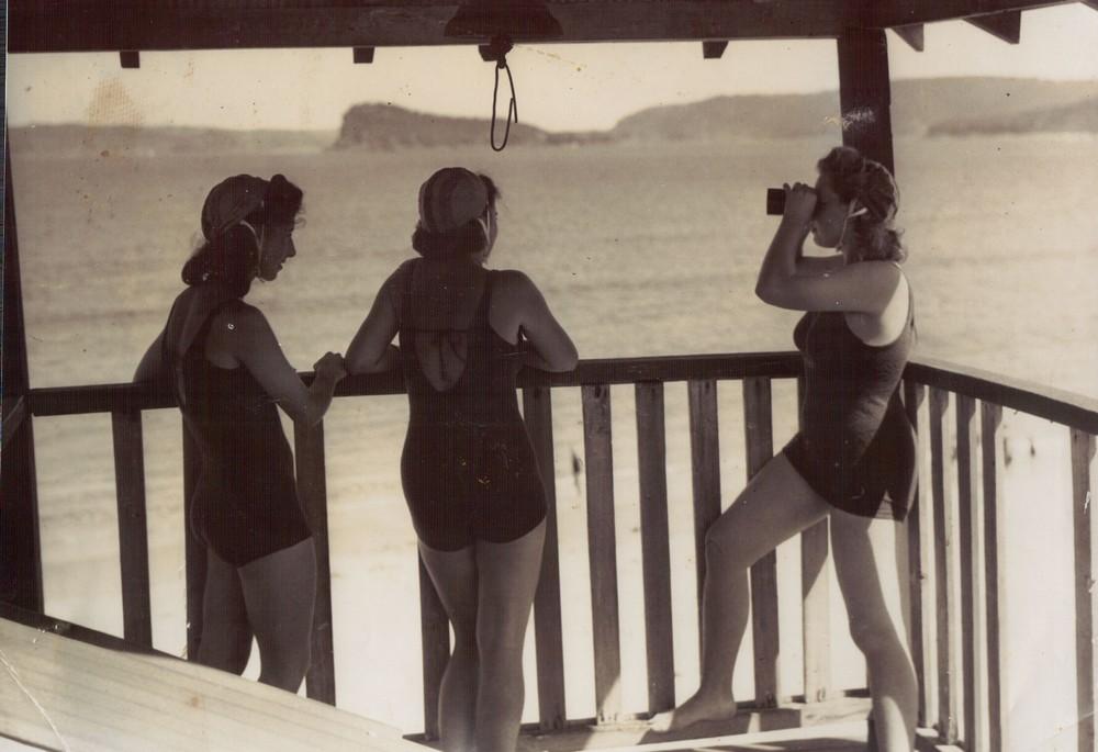 149 OB women patrol with binoculars